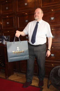 Clive holding trickers bag.jpg